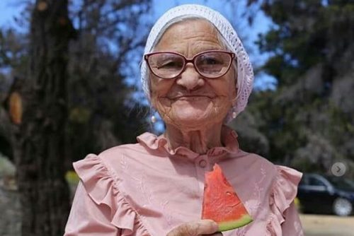 A grandmother wearing a babushka